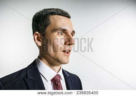 Three-quarter Portrait Of A Businessman With Surprised And Smiling Face. Confident Professional With