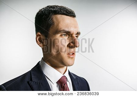 Three-quarter Portrait Of A Businessman With Disgust Face. Confident Professional With Piercing Look