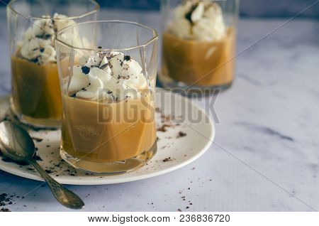 Caramel Dessert Decorated With Whipped Cream And Grated Chocolate