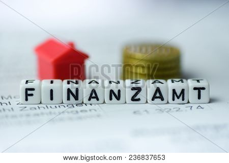 German Word Tax Office Formed By Alphabet Blocks: Finanzamt Real Estate Business