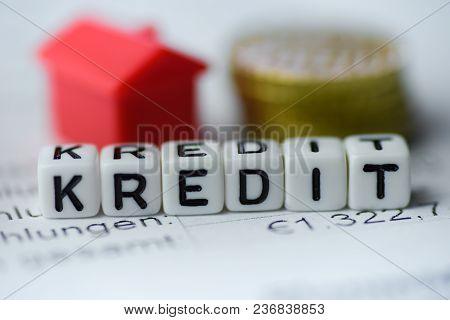 German Word Credit Formed By Alphabet Blocks: Kredit Real Estate Business