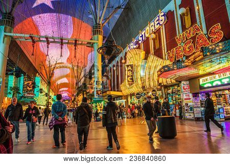 Las Vegas, Usa - January 3, 2018 : Fremont Street With Casinos, Many Neon Lights And Tourists In Dow