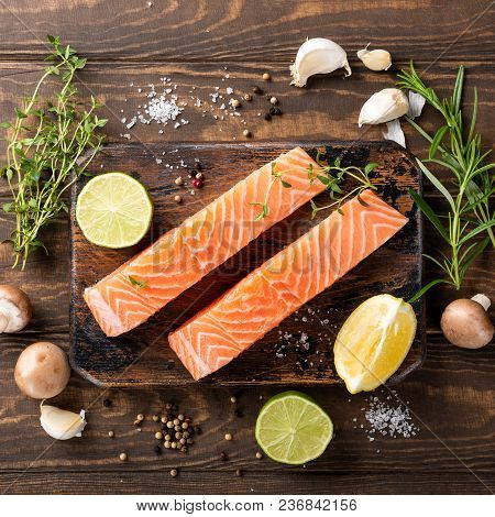 Flat Lay With Fresh Raw Salmon Fillet And Aromatic Herbs, Spices, Pepper, Salt, Mushrooms Lemon And