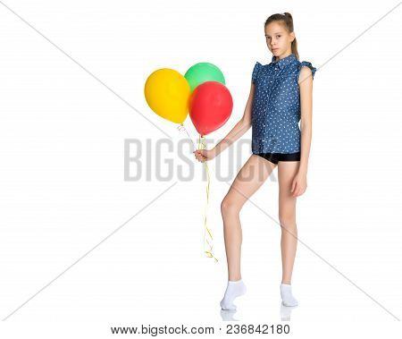 Beautiful Teen Girl With Helium Balloons In Hand. Concept Happy Childhood And Holidays. Isolated On