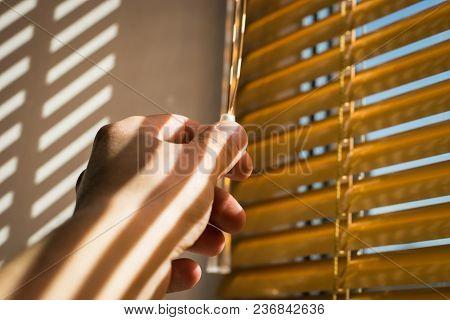 Window Jalousie. Hand Opening Or Closing Jalousie On Pvc Window