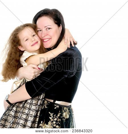 Young Mother And Little Daughter Gently Embrace. The Concept Of Happy Childhood, Family Happiness, R