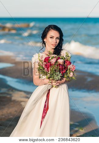 Closeup Portrait Of Pretty Bride In Luxury Wedding Dress With Bouquet At The Sea Side. Wedding By Th
