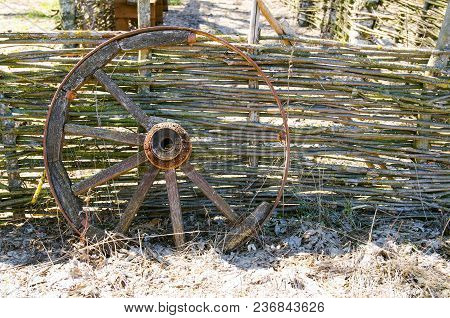 Old Wooden Cart Wheel. The Concept Of Outdated Technologies, Ecotourism