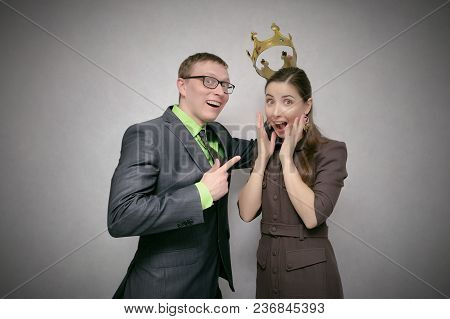 The Leader Man Dresses The Golden Crown On The Winner Head Isolated On Gray Background. Award Ceremo