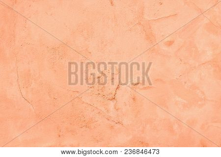Old Cement Plaster Wall Texture. Peach Color Painted Background