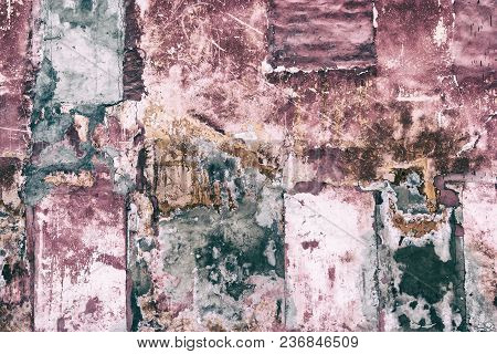 Old Patched Shabby Concrete Wall With Cracked Detached Paint. Abstract Grunge Background