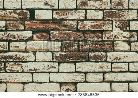 Old Painted Brick Wall Texture. Aged Brickwork. Retro Style Grunge Background