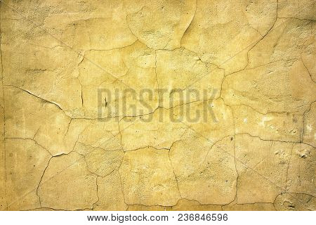 Old Cracked Weathered Concrete Wall. Aged Yellow Surface. Retro Background