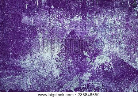 Old Shabby Concrete Wall Texture With Cracked Purple Paint. Abstract Grunge Background