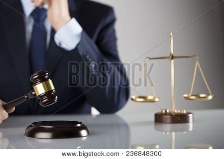 Man In Suit On White Background. Law Business Concept. Judge Gavel, Scale Of Justice.