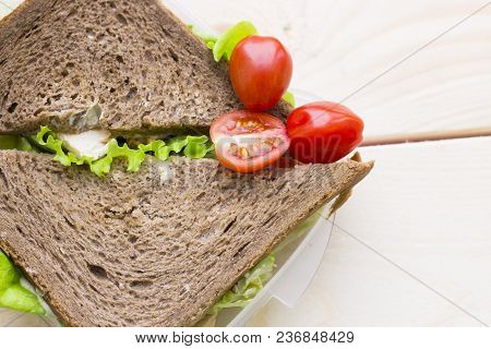 Healthy Lunch Concept. Rye Bread Sandwich With Chicken, Lettuce And Cherry Tomatoes In A Lunch Box,