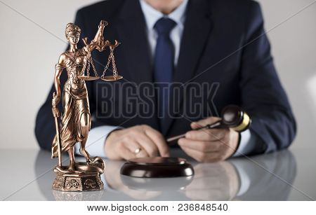 Man In Suit On White Background. Law Business Concept. Judge Gavel, Statue Of Justice.