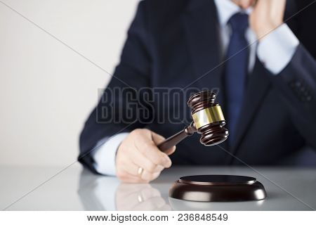 Man In Suit On White Background. Law Business Concept. Judge Gavel.