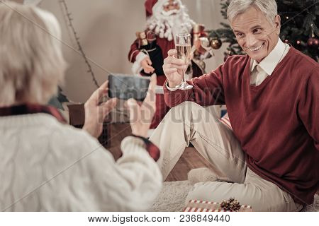 Old Model. Happy Male Person Keeping Smile On His Face And Wrinkling Forehead While Demonstrating Bo