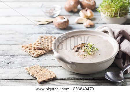 Mushroom Cream Soup In A Bowl Over White Wooden Background