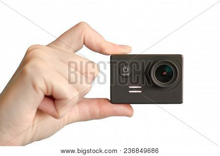 Action Camera In Hand. Hand With Action Camera On White Background.