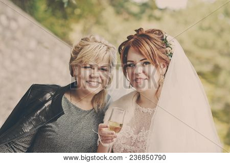 Redhead Pretty Bride With Her Attractive Mother
