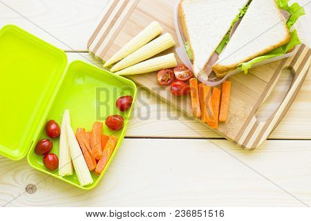 Healthy Lunch Concept. Lunch Box Food Assortment: Sandwiches, Baby Corns, Cherry Tomatoes, Carrots,