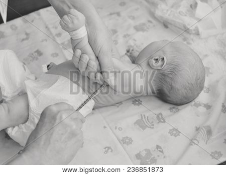 Doctor Vaccinating Newborn Baby At The Prenatal House