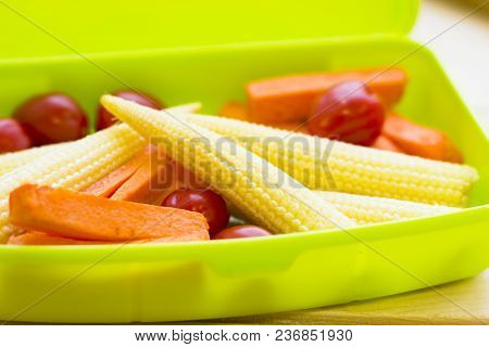 Healthy Lunch Concept. Baby Corns, Cherry Tomatoes, Carroots In A Green Lunch Box, Close Up
