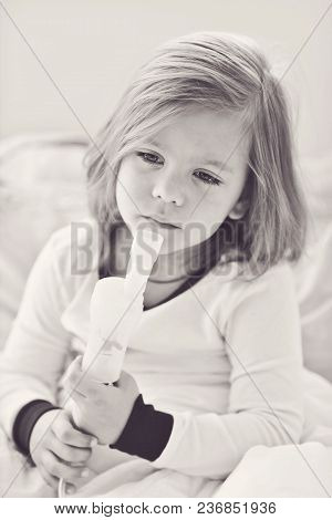 Little Girl With Cough Using Inhaler At Home