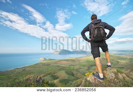 Man and mountain sea landscape. Emotional and conceptual scene.