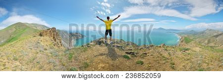 Man and mountain sea landscape panorama. Emotional and conceptual scene.