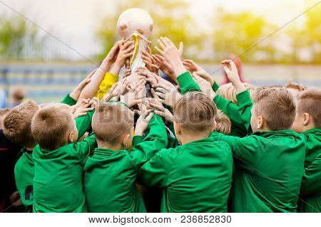 Kids Celebrating Soccer Victory. Young Football Players Holding Trophy. Boys Celebrating Sports Cham