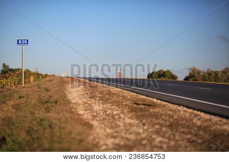 An Empty Asphalt Road In The Steppe At Sunset. The Astrakhan Region. Russia.