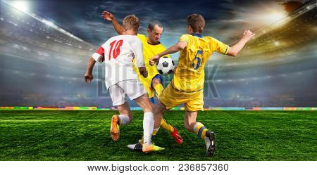 Soccer ball on the field of stadium with light.  Footballer goes to the Takaku at the opponent's gate .