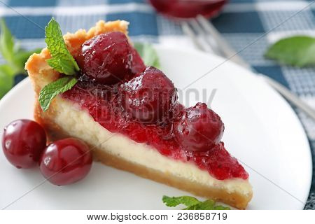Delicious cheesecake with cherries on plate