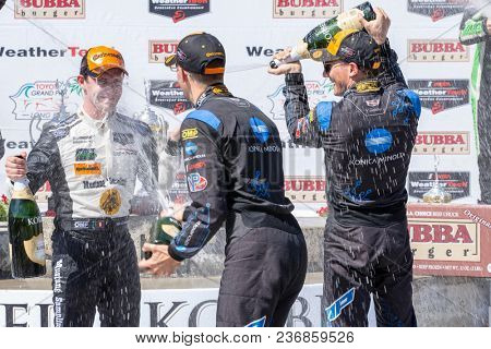April 14, 2018 - Long Beach, California, USA:  Filipe Albuquerque gets drenched with champagne after winning the Bubba Burger Sports Car Grand Prix in Long Beach, California.