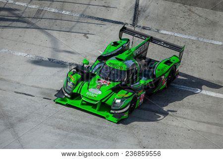 April 13, 2018 - Long Beach, California, USA:  The Tequila Patron ESM Nissan DPI car races through the turns at the Bubba Burger Sports Car Grand Prix At Long Beach n Long Beach, California.