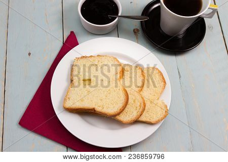 A Traditional French Breakfast With Brioche Loaf Of Bread