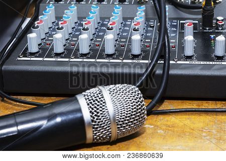 Professional Condenser Studio Microphone Over The Musician Blurred Background And Audio Mixer, Music