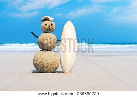 Joyful Sandman Of White Sand On The Clean Beach Of An Exotic Island On The Background Of Blue Sea An