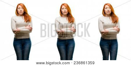 Young Beautiful redhead woman nervous and scared biting lips looking camera with impatient expression, pensive