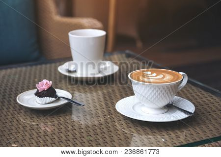 A Piece Of Snack And Two White Coffee Cups On Table In Cafe