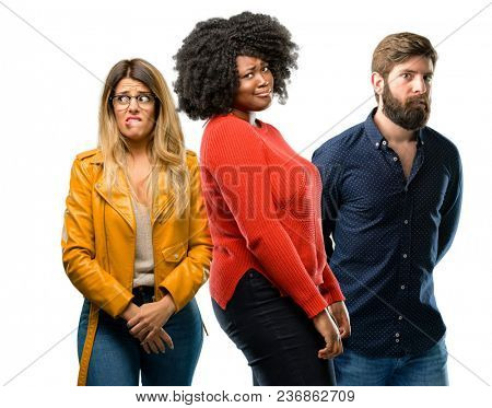 Group of three young men and women doubt expression, confuse and wonder concept, uncertain future