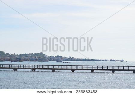 Walkway Cement Bridge Over The Sea And Shore Background On Sunny Day