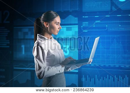 Skilled Programmer. Calm Clever Programmer Thoughtfully Looking At The Screen Of A Modern Laptop Whi