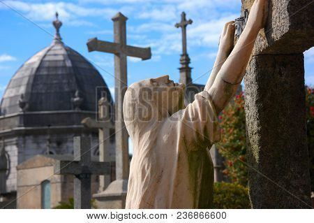 Porto, Portugal - A Tomb Statue Standing On The Knees And Holding To The Grave At Agramonte Cemetery
