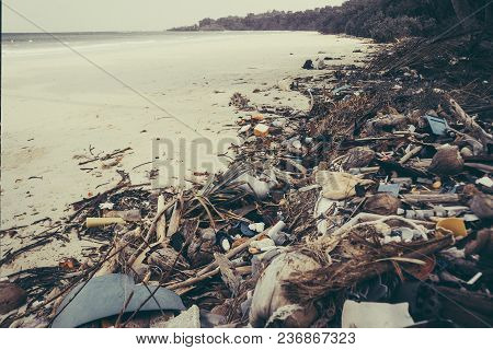 Fishermen Live Along The Coast, Leaving Plenty Of Waste On The Coast And Throwing It Into The Sea. M
