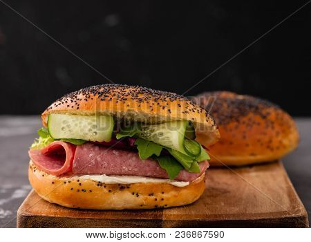 Sandwich With Salami, Fresh Salad On A Wooden Board, Copy Spase.