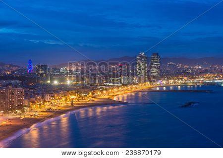 Aerial View Of Barcelona Beach In Summer Night Along Seaside In Barcelona, Spain. Mediterranean Sea